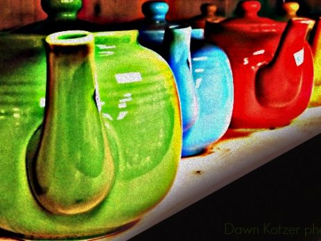 Colourful teapots on a shelf